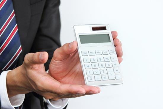 ビジネスマン、電卓